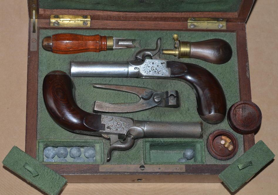 Fine Cased Pair of French or Belgian Percussion Muff Pistols, ca. 1850