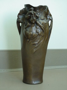LADY FACE ON VASE IN FLOWERS