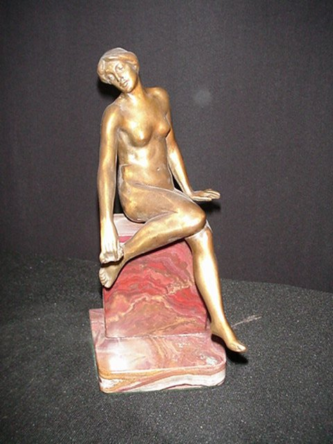 Bronze Figurine/Seated Girl on Wall