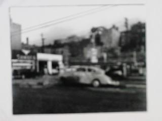 GREAT B/W PHOTO OF NEON CAR AND DRIVER