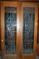 Pair Matching Oak Doors with beveled glass