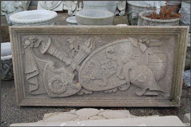Limestone Panel of Sword , shield and helmet.