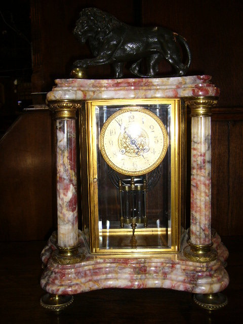 A Impressive French Portico Clock with Bronze Lion