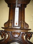 A Highly Carved French Walnut Barometer Features Winged Griffins