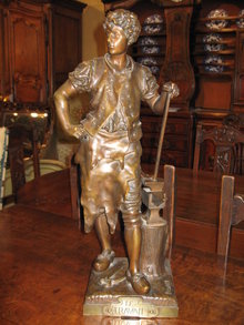 An excellent French bronze sculpture of a blacksmith