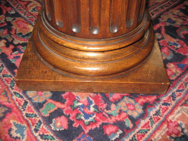 A handsome French carved walnut pedestal