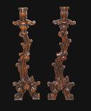 Pair of Carved Italian Walnut Candlesticks