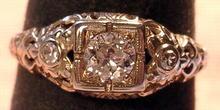 18K WHITE GOLD FILIGREE RING .50 CARAT DIAMOND 2 SIDE STONES