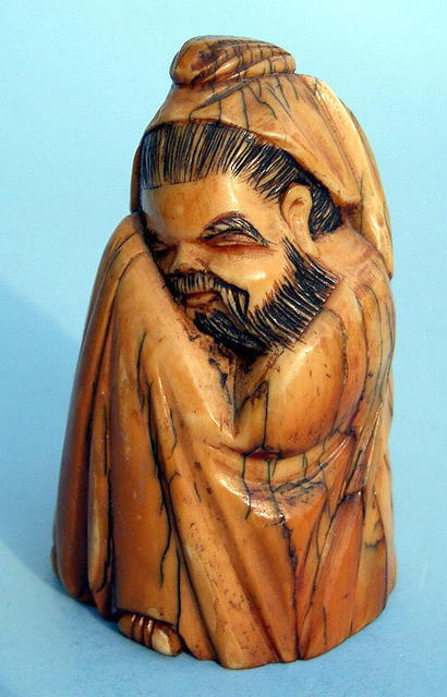 JAPANESE IVORY FIGURE OF A SEATED SCRIBE NICE