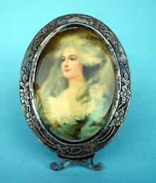 FINE STERLING AND CELLULOID PICTURE FRAME NEAT