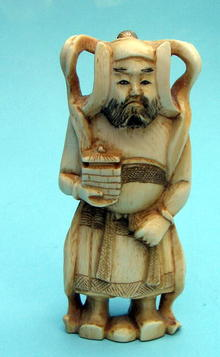 NICE CHINESE OKIMONO IVORY OF DIETY OR EMPEROR