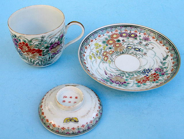FINE MEIJI JAPANESE SATSUMA COVERED CUP AND SAUCER
