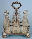 FINE ENGLISH STERLING 7 BOTTLE CASTOR SET FRAME 1861