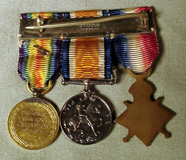 Very nice set of English WWI medals from the firm of Spink and Son Piccadilly. Includes original box extra ribbon and 3 medals set on a bar pin. Fantastic set in excellent condition. About 2