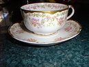 Haviland Limoges tea cup and saucer, roses & gold