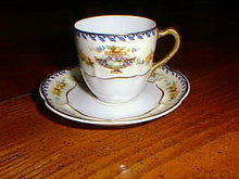 Haviland Limoges demitasse  cup and saucer in the Charm pattern