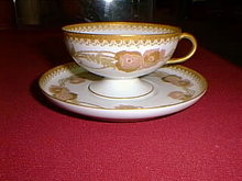 Haviland Limoges Fancy pedestal tea cup and saucer, lots of gold