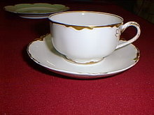 Haviland Limoges tea cup & saucer, Ranson with gold edge.