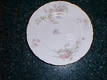 Haviland Limoges bread/butter plate, wreath of pink roses w/blue ribbons