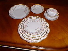 Haviland Limoges place setting in a variation of Sch 659