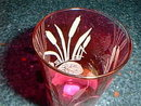 Cranberry glass tumbler with etched design