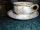 Haviland Limoges tea cup and saucer, heavy gold trim