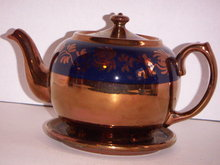 COPPER LUSTRE TEAPOT & MATCHING TEA TILE