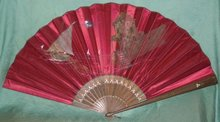 Antique fan with fishing boat and ghost house