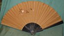 Antique fan with a rat and a guitar