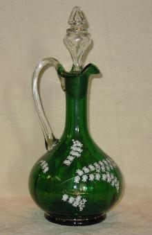 Green decanter with lilies of the valley on it