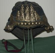 Old  chinese cap for a child with metal decorations