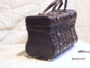 Sewing basket with celluloid  plaited in it .