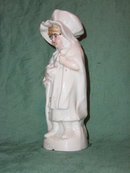 Porcelain Figurine of Child in  Night Gown