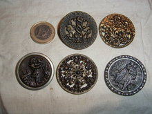One button with cut steel and 4 antique ones.