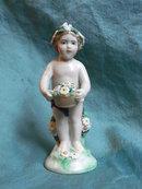 Höchst porcelain cherub with flowers
