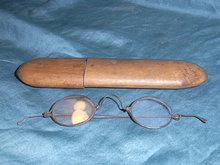 Pair of antique spectacles in a wooden case