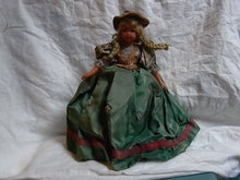 Celluloid doll with long dress on.