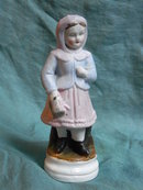 19th century  porcelain figurine of a  little girl