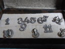 Set of silver plated glass numbers