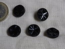 7 black glass buttons