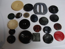 19 early plastic, wooden and other buttons.