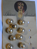 9  glass pearl buttons.