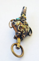 19th Century Gold Urn shaped Watch Key with Grape and Vine Decoration