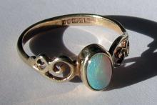 English Opal Dress Ring with scrolled shoulders