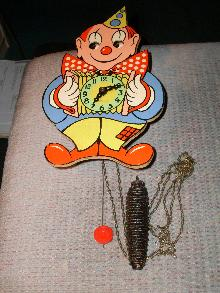 Vintage Germany Wind-up CLOWN Wall CLOCK _ wooden construction_ pendulum_weight