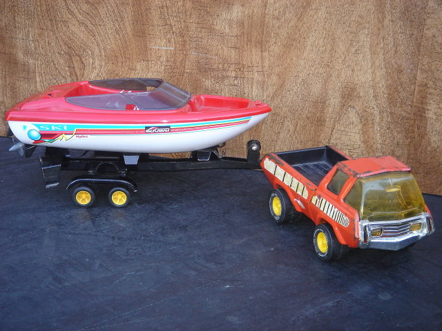 Collectible TONKA Pick-up Truck Pressed Steel  with TONKA Boat Trailer and Nylint Brand Plastic Boat