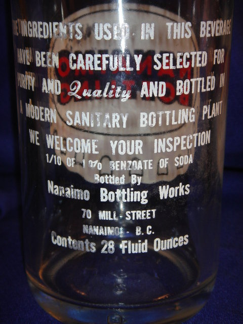 Collectible POP BOTTLE ~ LARGE 28 fl oz NANAIMO BOTTLING  ~ Quality Beverages ~ 70 Mill Street Nanaimo, B.C. ~ White + Red Lettering with POP CAP Logo