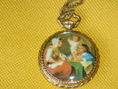 LADIES PENDANT Gold Style  DUMAI MECHANICAL WIND-UP  Watch  with Antique Famous Masters Scene on the Back  ~ Swiss Made. ~ EXCELLENT WORKING ORDER  Size 1.25 Inches Wide
