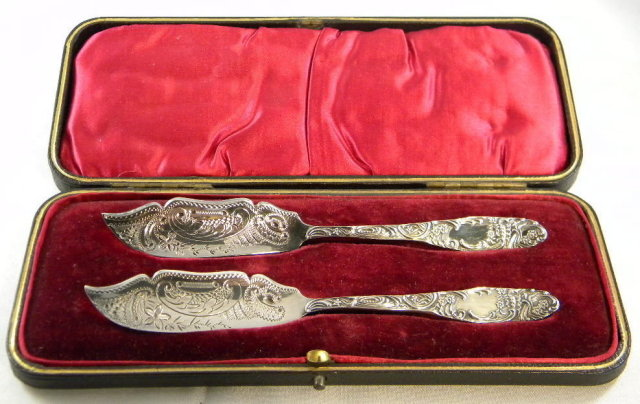 Heavily Engraved Victorian Silver Butter Knives, boxed 1897