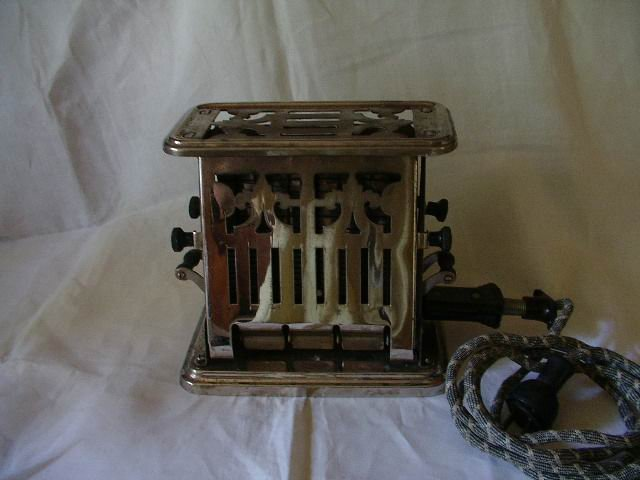 Antique Electric Toaster by Universal Ebony